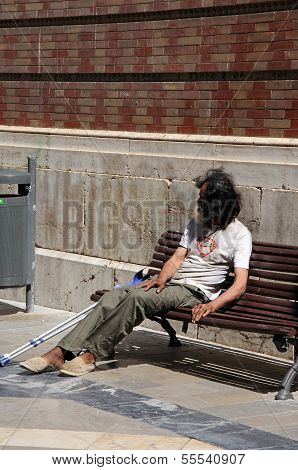 Tramp on bench, Malaga, Spain.