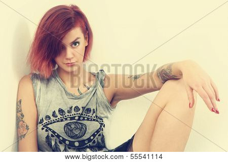 retro photo of young tattooed girl