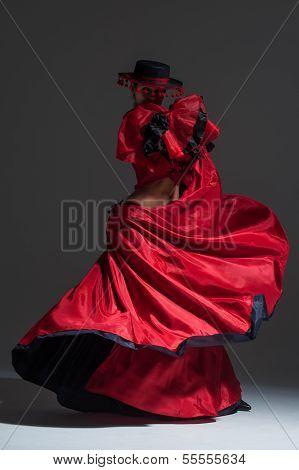 Woman In Beautifull Red Dress Dancing In A Studio