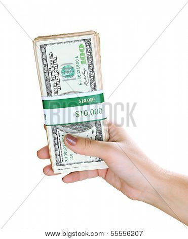 Packs of dollars in hand isolated on white