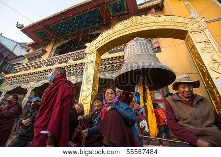 KHATMANDU, NEPAL - DEC 15: Unidentified Buddhist pilgrims near stupa Boudhanath during festive solemn Puja of H.H. Drubwang Padma Norbu Rinpoche's reincarnation's, Dec 15, 2013 in Khatmandu, Nepal.