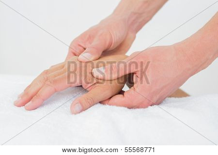 Extreme close-up of a doctor examining a female patient's hand in the medical office
