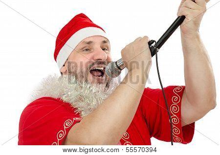 Happy Guy In Santa Suit Singing In Microphone