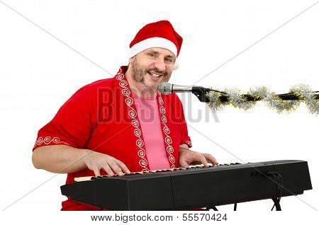 Man In Santa Claus Suit Having Fun With Electric Piano