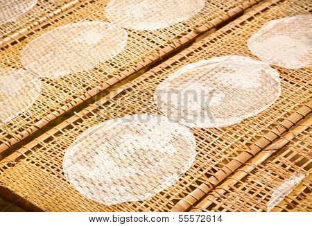 Drying Vietnamese Rice Paper Under Sun, Vietnam.