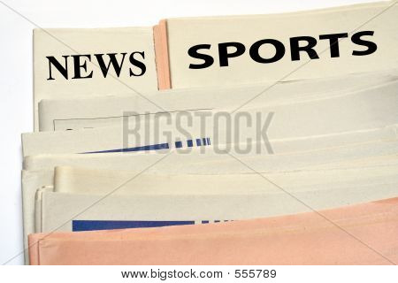 Stacked Sports Newspapers