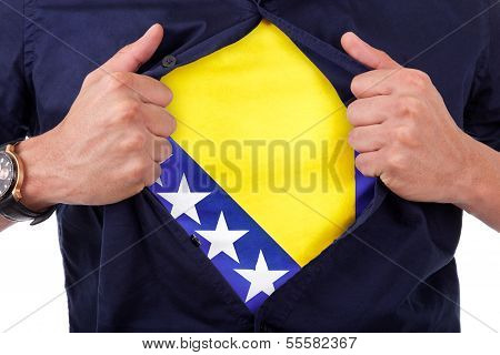 Young Sport Fan Opening His Shirt And Showing The Flag His Country Bosnia, Bosnian Flag