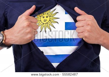 Young Sport Fan Opening His Shirt And Showing The Flag His Country Uruguay, Uruguayan Flag
