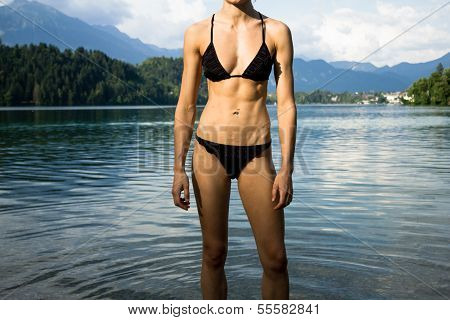 Woman In Bikini Relaxing In A Mountain Lake