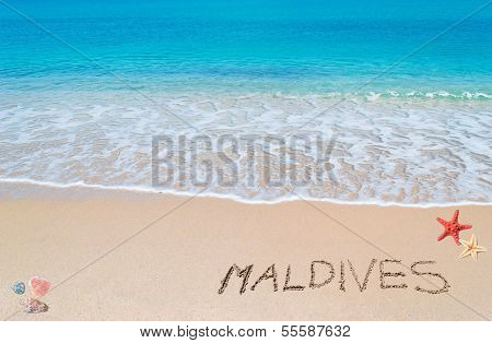 "Turquoise Foreshore With ""maldives"" Written On It"