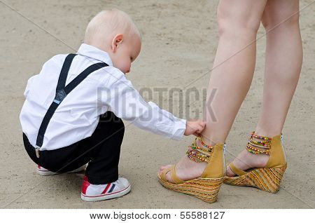 Baby Boy Examines Female Shoes