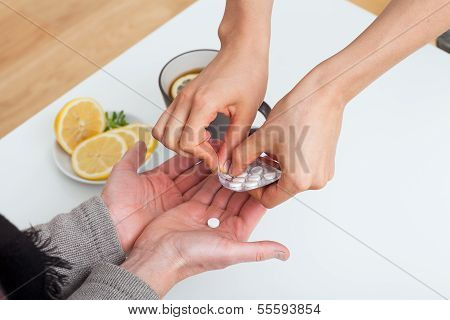 Giving A Medicine To A Patient