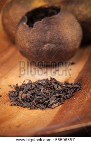 Chinese Dark Tea Pu-erh On Wooden Table