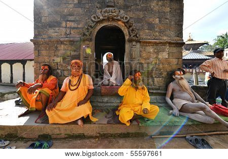Holy Sadhu Men With Dreadlocks And Traditional Painted Face In Pashupatinath, Nepal