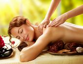 Spa. Beautiful Woman in Spa Salon getting Massage. Healthy massage of body in spa salon. Beauty treatment concept. Masseur doing massage. Relaxing poster