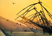 image of fishnet  - Chinese fishing net at sunrise in Cochin  - JPG