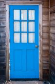 picture of mendocino  - Bright blue door of a Mendocino cabin - JPG
