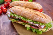 stock photo of cucumbers  - Long Baguette Sandwich with lettuce - JPG