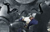 picture of mechanical engineer  - two engineers working inside giant gear machinery - JPG