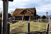 image of household farm  - Old authentic village with wooden houses and straw on roof - JPG