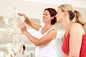 foto of physiotherapist  - Professional physiotherapist explaining the shoulder to a patient - JPG