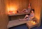 Girls Relaxing In A Sauna