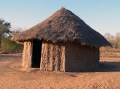 stock photo of mud-hut  - Straw roof hut in an African village - JPG