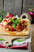 picture of tarts  - Apple tart with cinnamon on an old wooden table - JPG