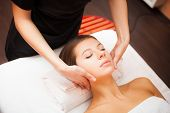 stock photo of facials  - Beautiful woman receiving a facial massage - JPG
