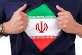 stock photo of iranian  - Young sport fan opening his shirt and showing the flag his country iran iranian flag - JPG