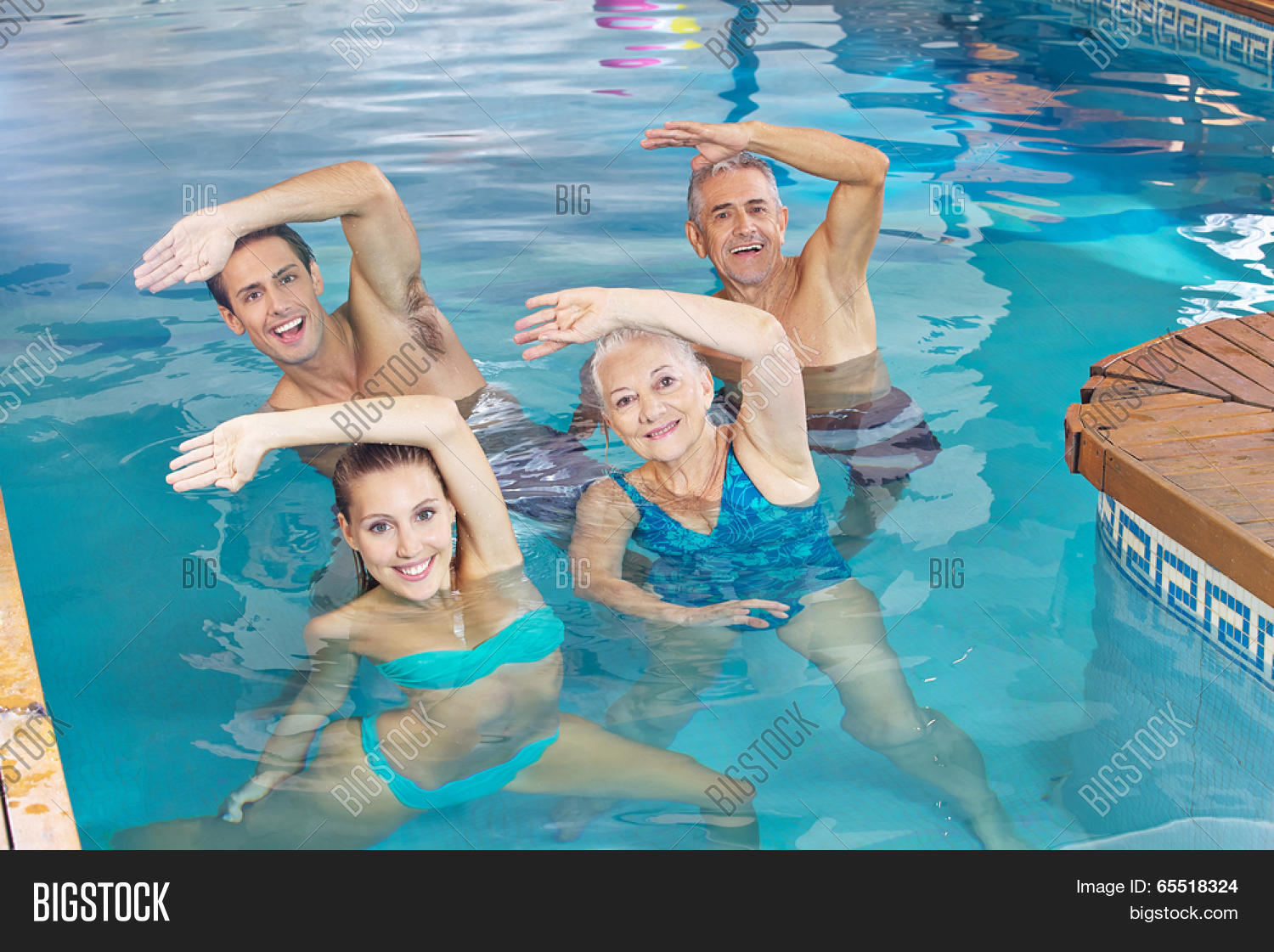 Happy Group Doing Aqua Fitness Class In A Swimming Pool