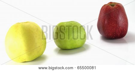 Thre Different Apples On A White Background