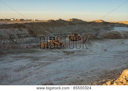 Bulldozers.
