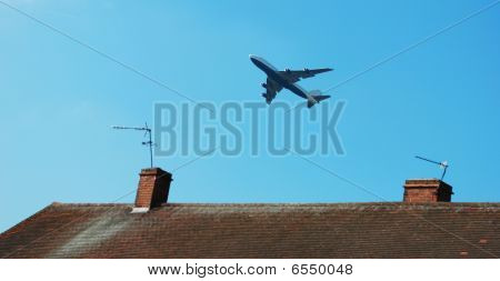 Airplane above house