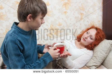 Son Giving His Mother Tea