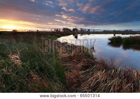 Sunrise Over Wild River