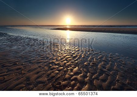 Sunset Over Sand Beach On North Sea