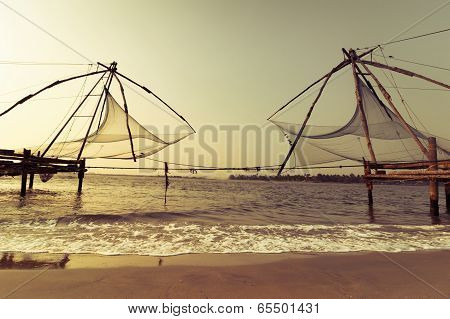 Sunset At Tropical Beach With Chinese Fishing Nets
