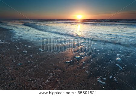Sunset Over North Sea Sand Beach