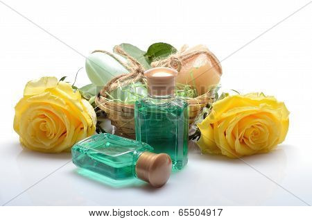 Mini set for spa, sauna bath - small bottles of shampoo, soap and flowers in still life