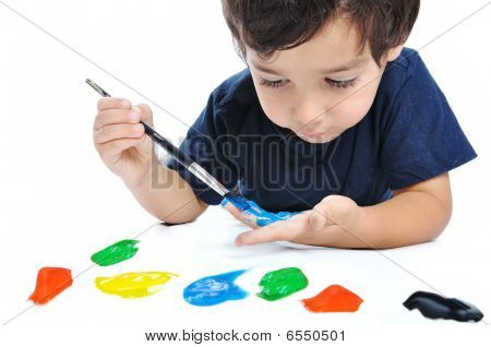 Kid playing with colors on white background