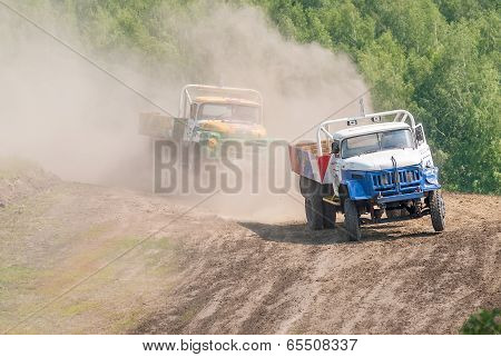 Trucks racing on unpaved track