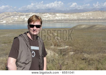 Man On Toktogul Reservoir