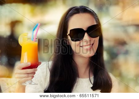 Young Woman with Sunglasses and Colorful Cocktail Drink Outside