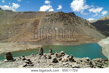 Suraj Taal Mountain Lake With The Buddhist Stupa At The Forefront