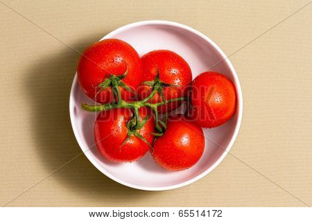 Bunch Of Ripe Tomatoes In A Bowl On A Cotton Cloth