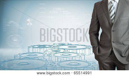 Businessman with high-tech gears and graphs