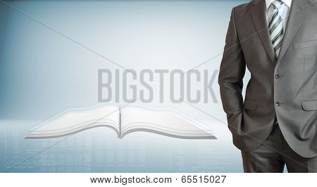 Businessman with open book