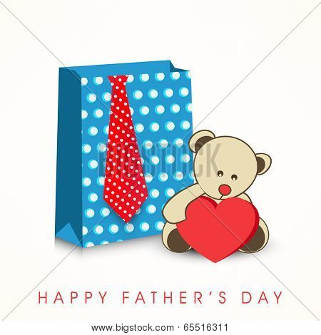 Happy Father's Day celebrations concept with shopping bag, necktie and teddy bear holding red heart shape on grey background.