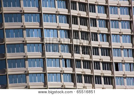 Blue Sky Reflecting In Windows Of Holiday Complex